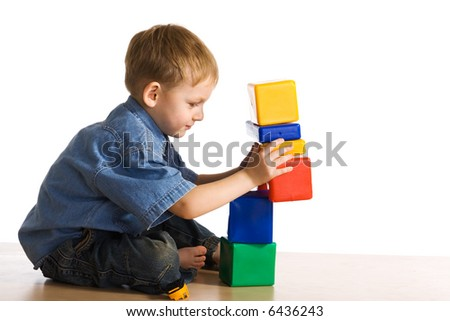 Child plays about cubes - stock photo