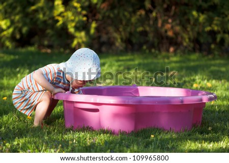 Child plays in sandpit on the playground