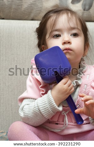 child plays with a shovel