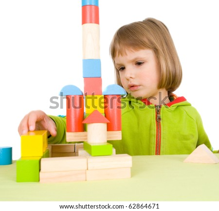 child plays with toy blocks