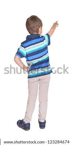 Child  pointing at wall. Rear view. Isolated over white . - stock photo