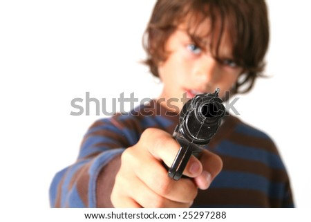 child pointing gun at camera. young boy with firearm weapon - stock photo