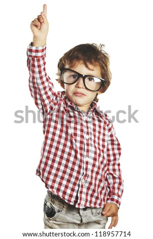 Child pointing up with his finger Isolated over a white background. Boy with black glasses. Isolated over a white background - stock photo
