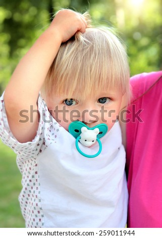 Child Portrait in the Summer Park - stock photo