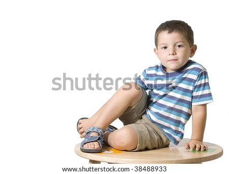 Child posing on a table ( isolated on white )