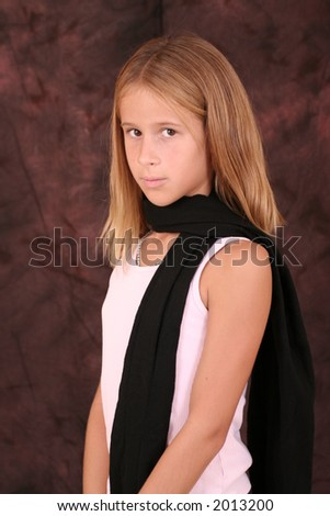 child posing with scarf