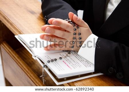 Child praying - stock photo