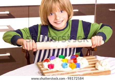 child prepares food - stock photo