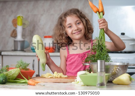 child  preparing healthy food vegetable salad
