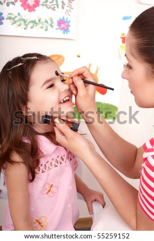 Child preschooler with face painting. Child care.