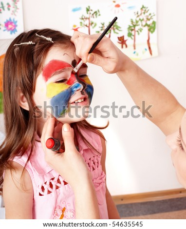 Child preschooler with face painting. Make up.