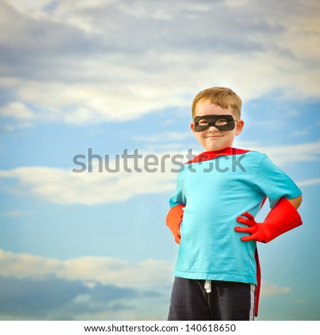 Child pretending to be a superhero with copy space - stock photo