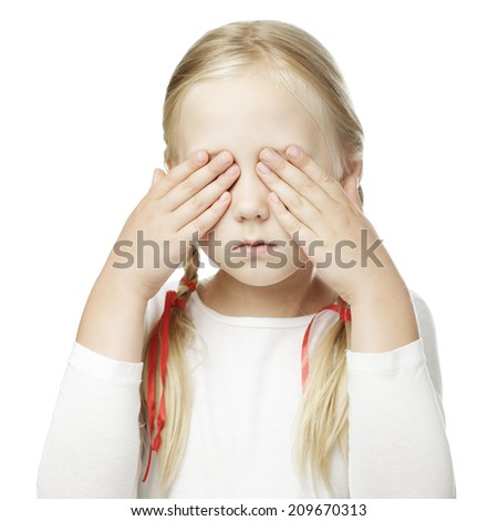 Child puts his hand over his eyes and sees nothing
