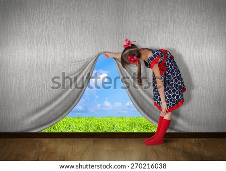 Child raise the wall and look on nature,  - stock photo