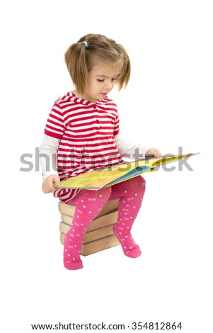 Child reading pile of books. white background - stock photo