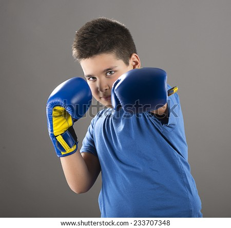 Child ready to swing left hook  - stock photo