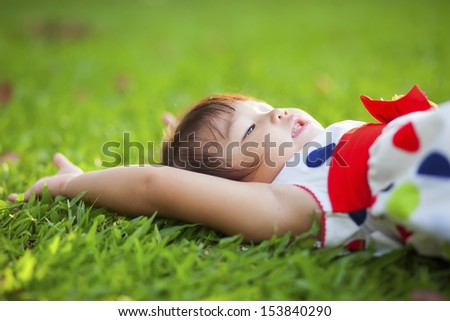 Child relaxing in the park.