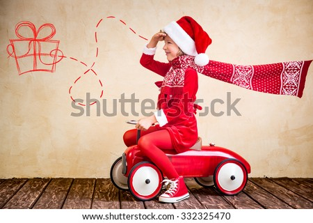 Child ride in red Christmas car. Xmas holiday concept - stock photo