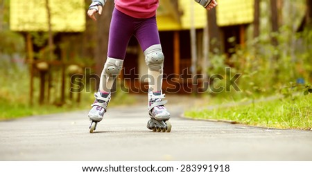child rollerblading outdoors. sport lifestyle. roller skating - stock photo