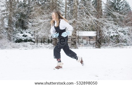 Child running in snow