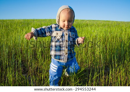 child runs across the field - stock photo