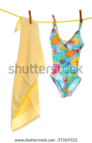 Child's bathing suit beach towel on clothes line - stock photo