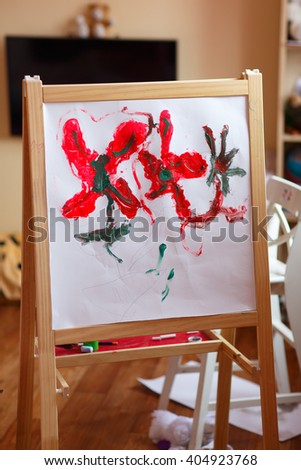child's drawing on the easel - stock photo