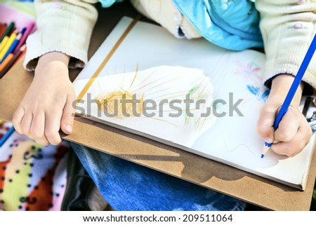 Child's drawing with a colored pencils - stock photo