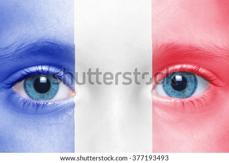 child's face with  french flag
