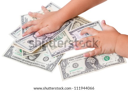 Child's hand and cash U.S. dollars isolated on a white background