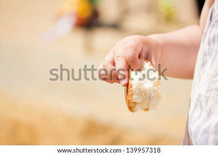 child's hand, bread