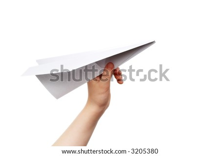 Child's hand launching white paper airplane