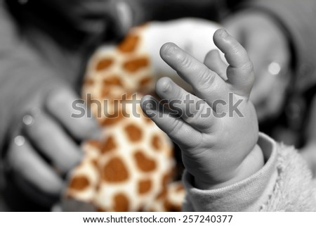 Child's hand playing on toy