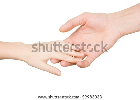 child's hand reaches for the male hand on a white background