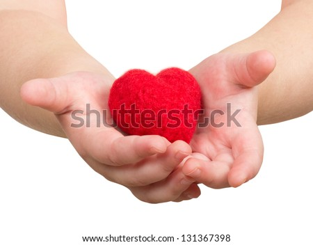 Child's hand with a red heart
