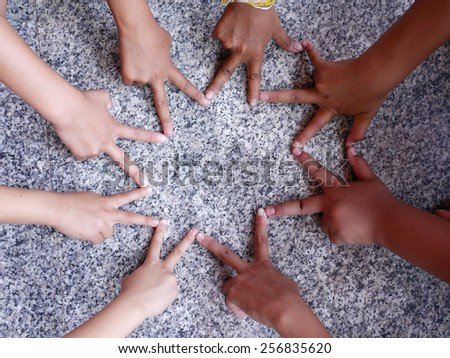 child's hands make the star - stock photo
