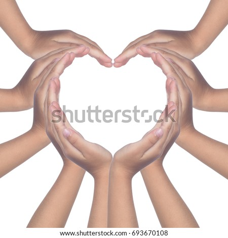 Child's hands making a heart shaped in isolated white background