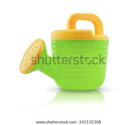 Child's plastic watering can isolated on white with clipping path - stock photo