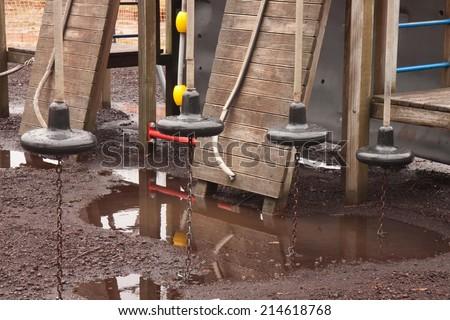 child's playground in the rain  - stock photo