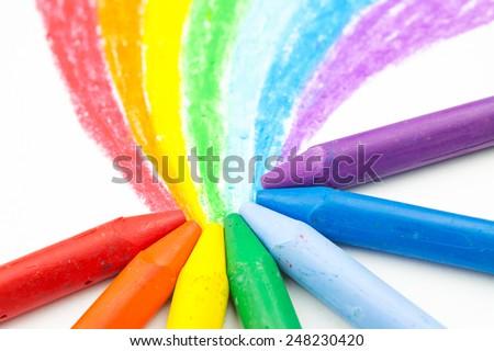 Child's rainbow crayon drawing - stock photo