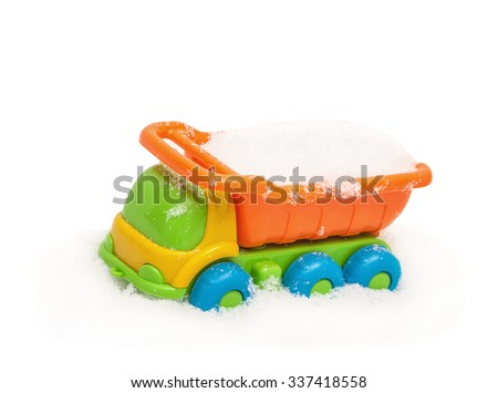 Child's toy truck in snow, covered snow, isolated on the white - stock photo