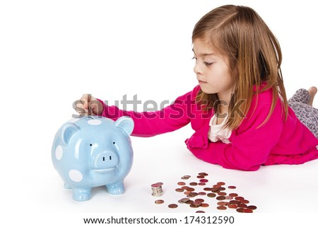 Child Saving money in a piggy bank - stock photo