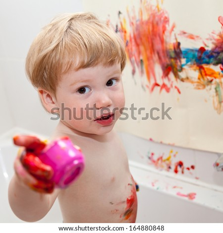 Child show you what he is drawing on the wall - stock photo