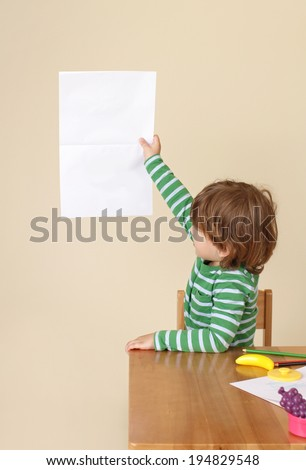 Child showing blank page, learning, school or education concept - stock photo