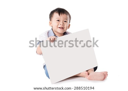 Child showing blank white board for your copy - stock photo