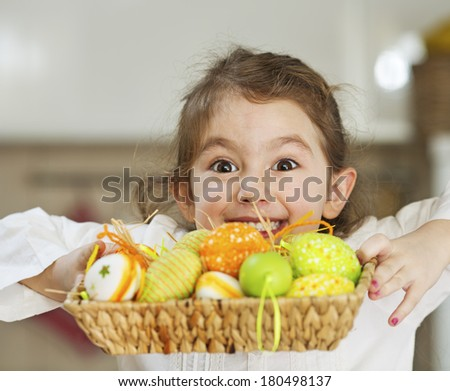 Child showing easter eggs to the camera and grimacing
