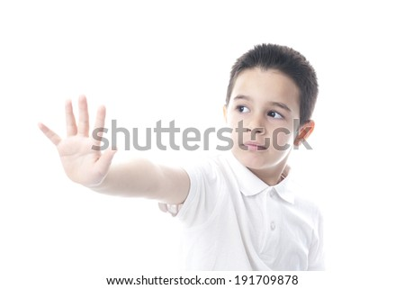 Child showing stop gesture. Isolated on white.