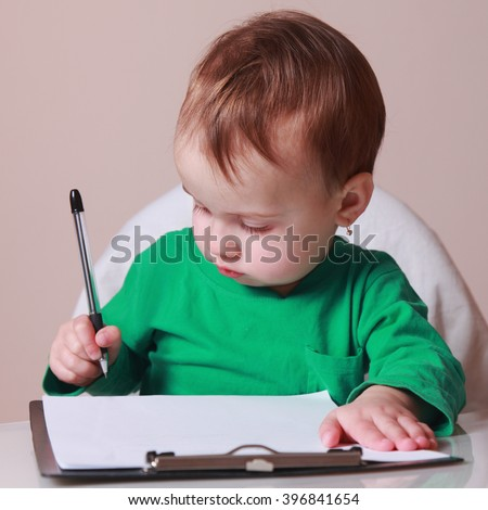 child signs a contract (humorous picture) - stock photo