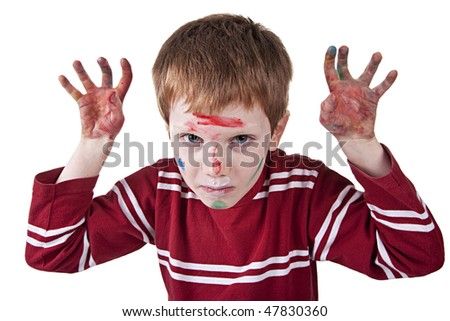 Child simulating threat, with both hands painted red and raised