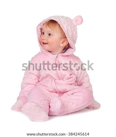child sitting in pajamas isolated on white background